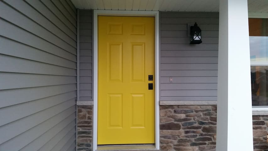 Easily find your way home with the only yellow door in the neighborhood