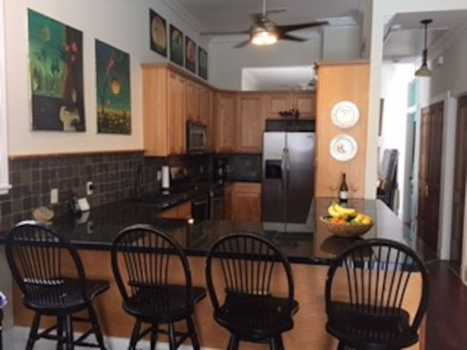 Gourmet  kitchen with Granite counter tops~ slate floors and stainless appliances