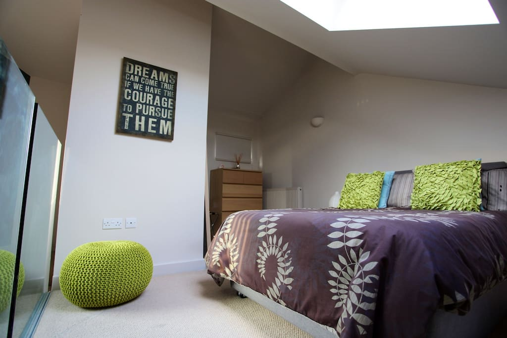 Comfy bedroom with double bed (Tempur orthopaedic mattress), chest of drawers, wardrobe alcove, luggage rack