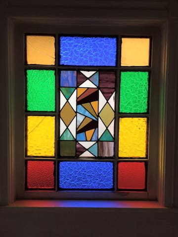 The focus of the room is an Eastlake stained glass window.