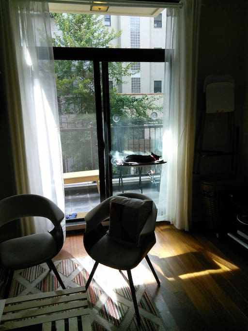 Sunny living room looking onto the balcony