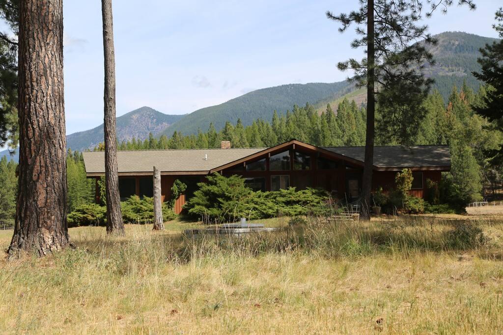 Custom home, floor to ceiling windows on ranch