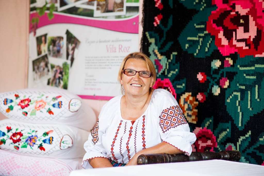 Liuba - your host, welcoming you to your home in Moldova.
