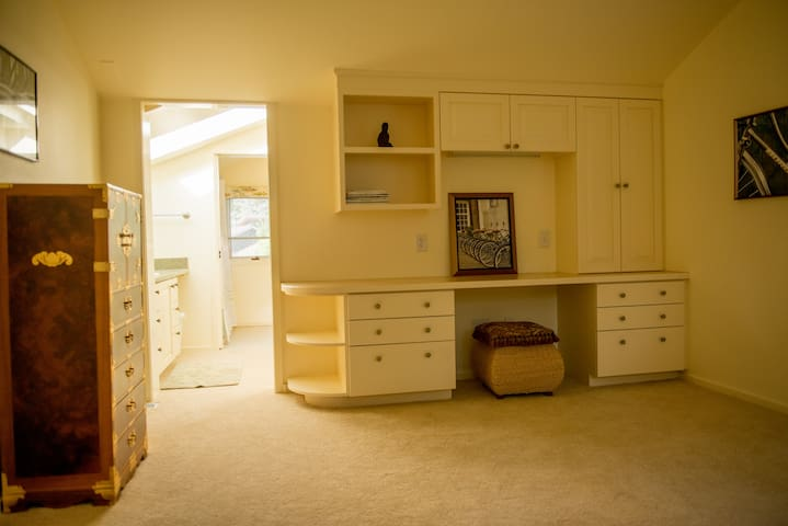 Built-in desk in bedroom with adjoining full bath and spacious closet.