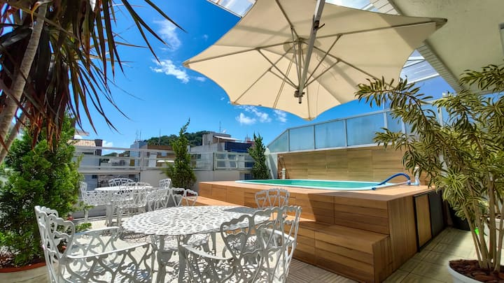 Penthouse with pool, two blocks from the beach!