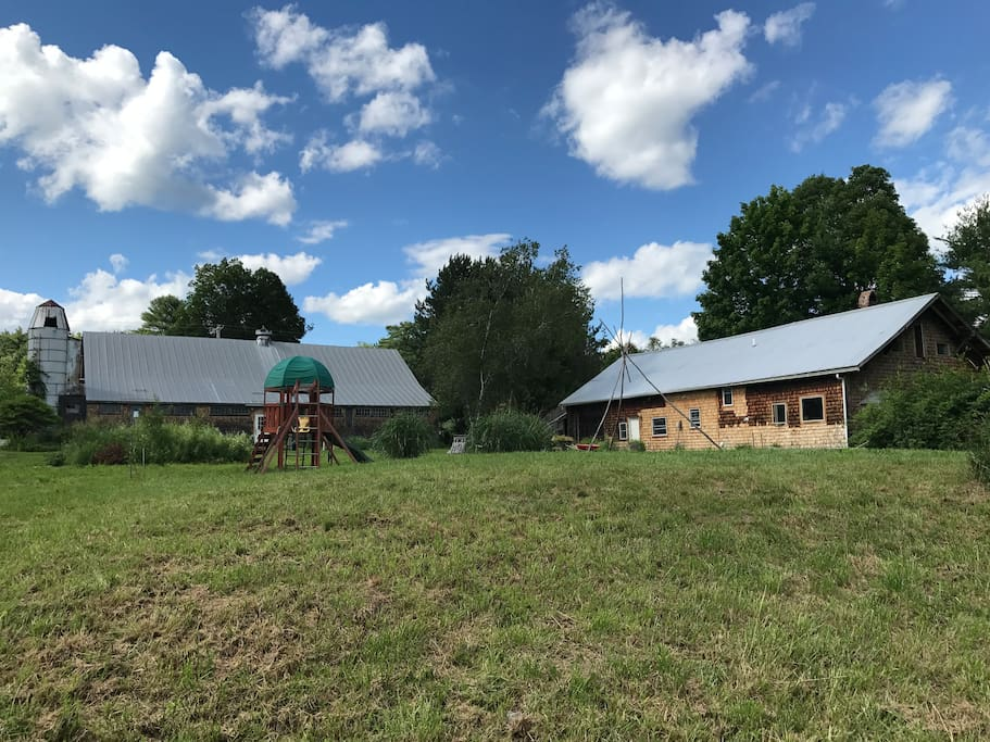 The house is on the right and the barn is on the left.