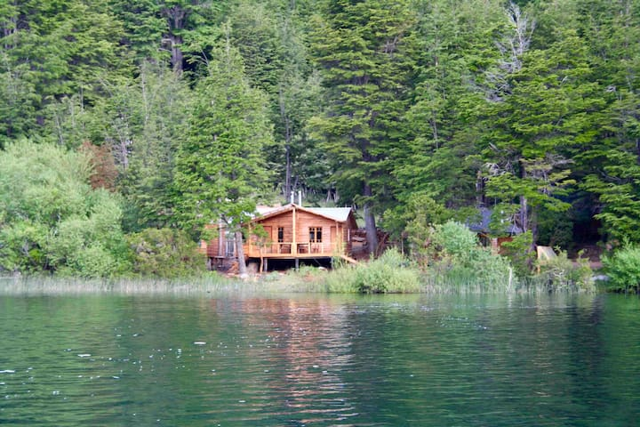 Foto from distance of the cabin and yes you can almost fish from the deck in front of the cabin!