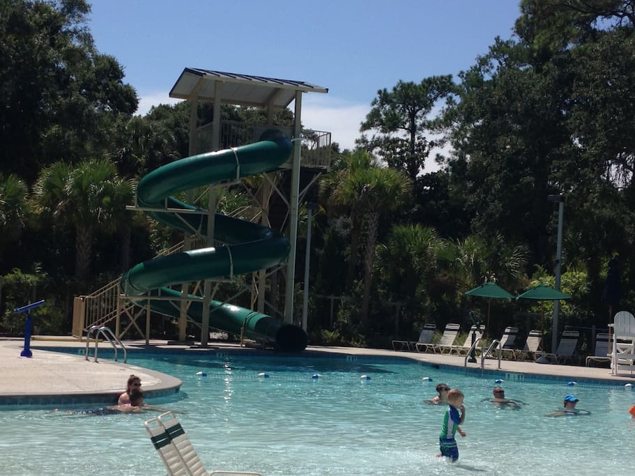 New family pool-3 minute walk from villa. Large pool, grassy area, Snack Bar~