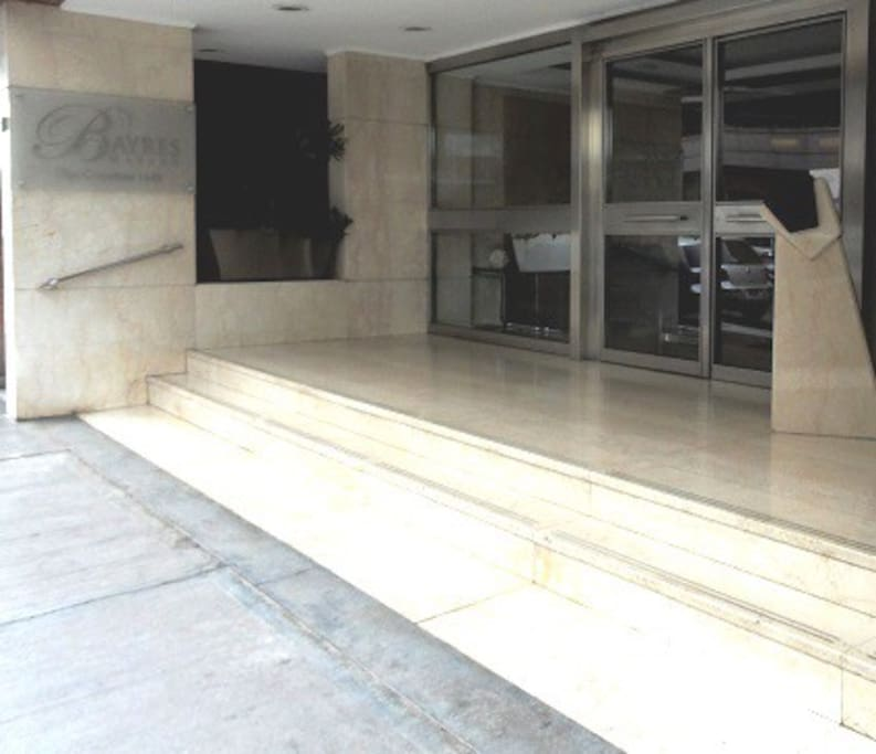 Shiny street-level entry into marble lobby.