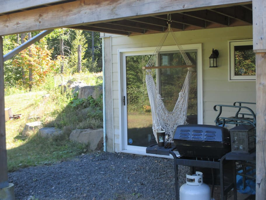 Private entrance, hammock and BBQ.