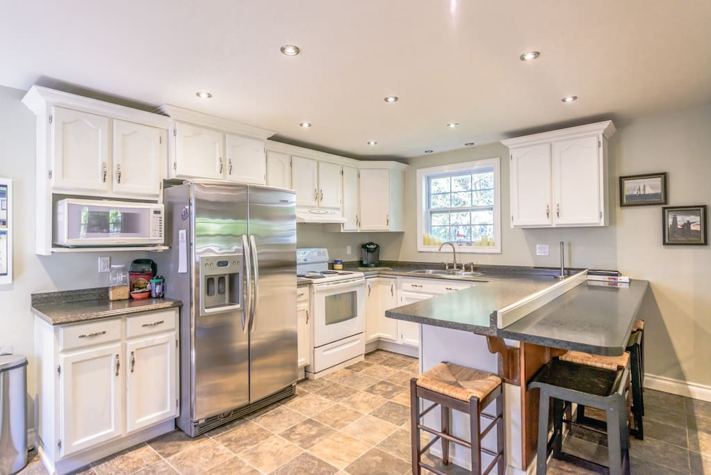 Kitchen comes fully equipped and has breakfast bar for additional dining