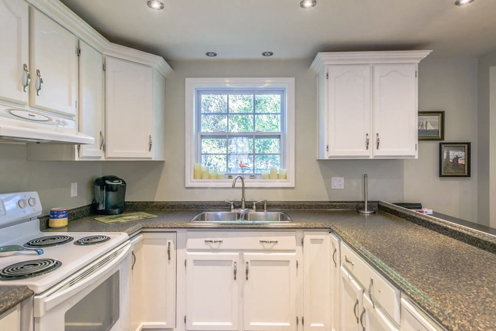 Kitchen has all modern appliances and fully stocked with dinnerware and cookware