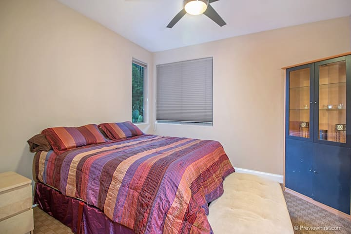 This is your bedroom.  The ceiling fan helps to keep a great air flow (with air conditioning when it's hot!)