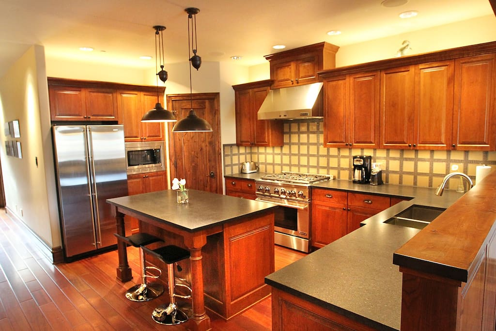 Kitchen, double sink, 6 burner gas stove with oven, microwave, and ample counter space along with pantry.