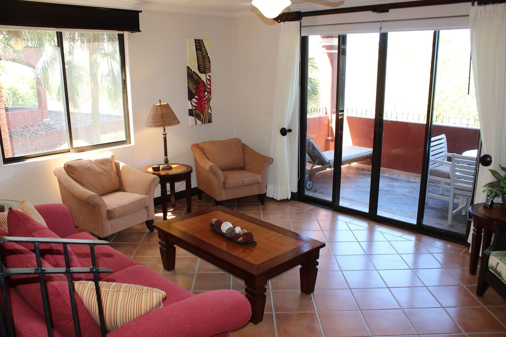 Living  room with comfortable seating featuring HD Smart TV, Stereo, DVD player and high speed internet.