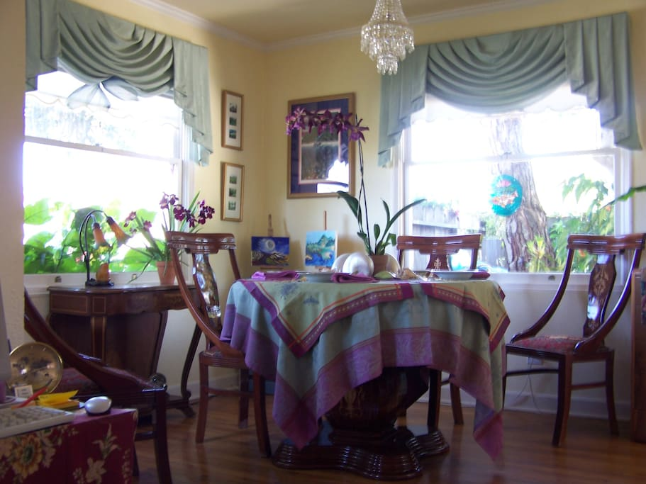 Large original windows give you dining views of front & side gardens