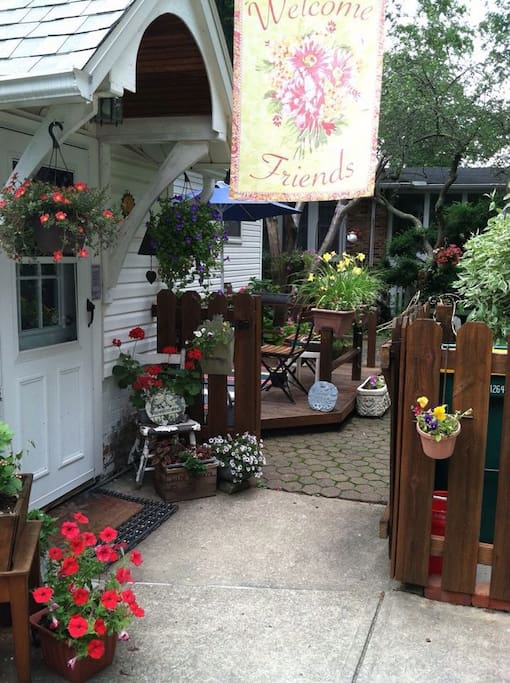 Enter/exit through back door with views of English garden. May read, enjoy morning tea/coffee on back deck.