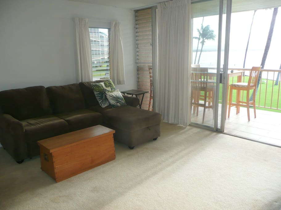 Living room opens to lanai, which overlooks the ocean