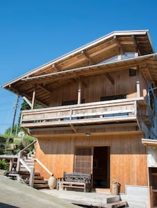 A wooden house where art is displayed with BBQsite