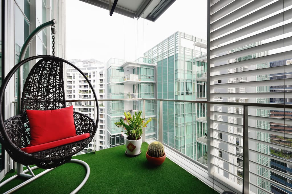 Come sit on the red cushion and enjoy the view of central Singapore from your private balcony
