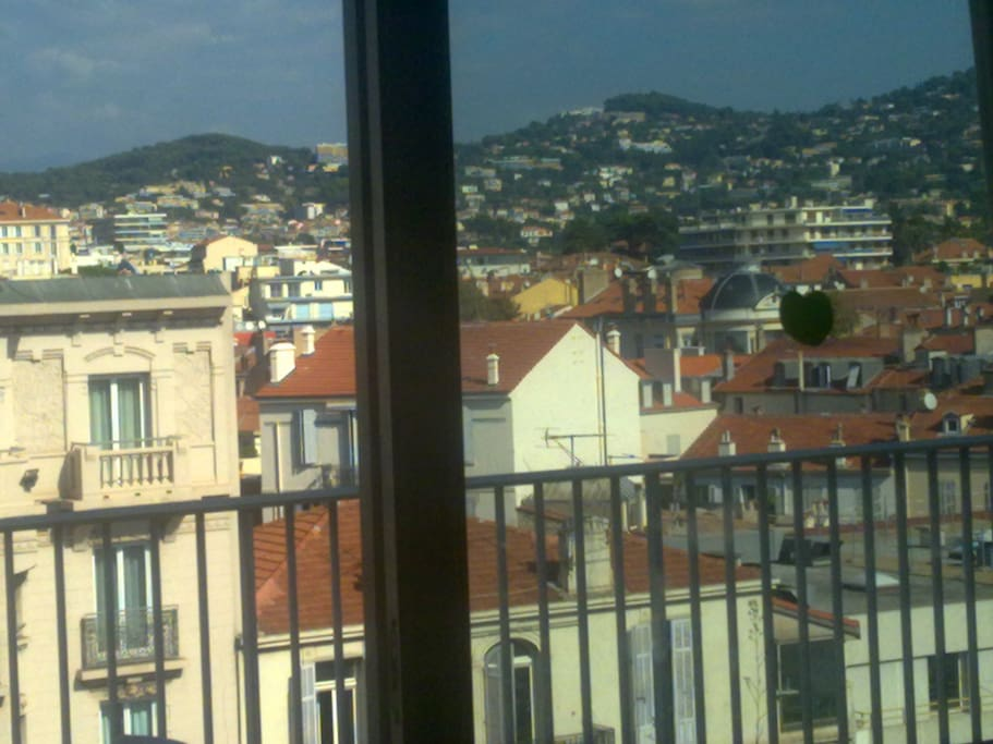 Balcony view to the Californie hills in the distance - our 2- bed, 8th floor studio with own bathroom & kitchenette in Cannes