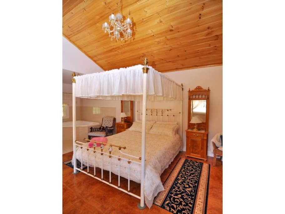 Four Poster Bed beside your own open fireplace.