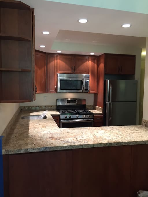 High end cabinets, granite countertops & recessed LED lighting.