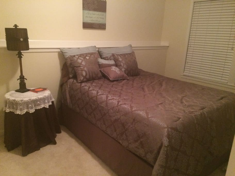 Queen size bed, walk in closet chest of drawers, and television in the Bedroom.