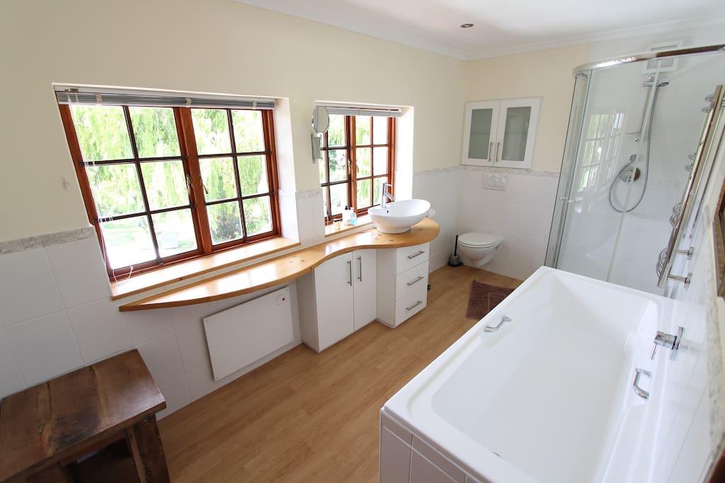 The ensuite bathroom with bath - the Balcony Room.
