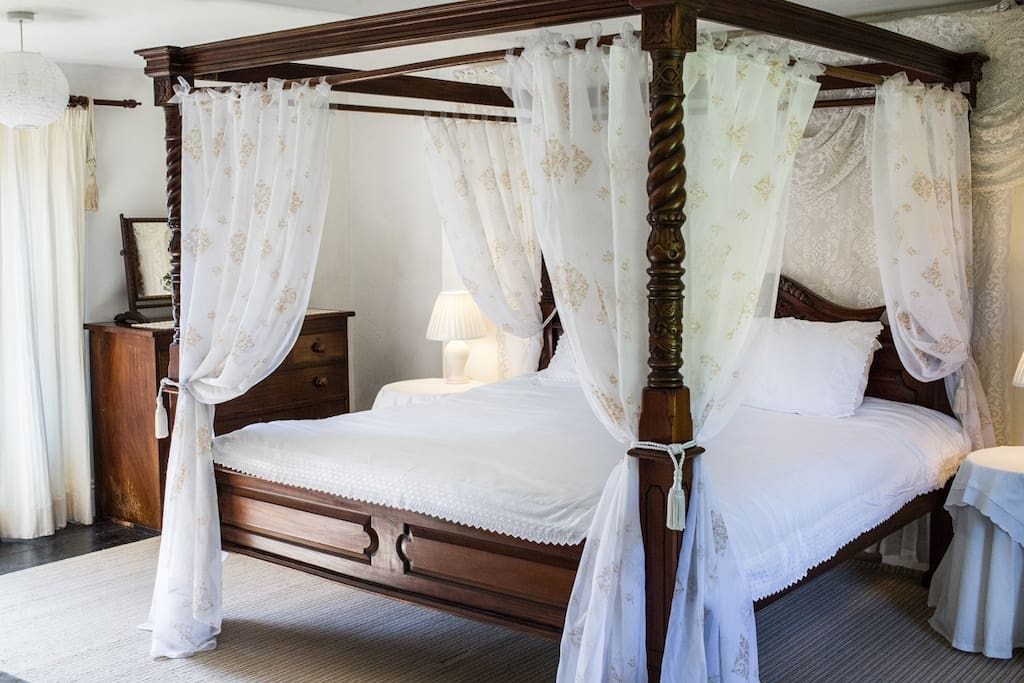 The master suite comes complete with a four poster bed for a luxurious nights sleep.