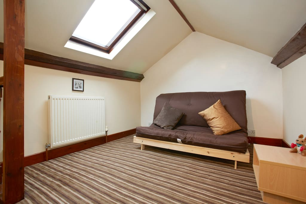 Comfortable attic bedroom conversion with skylight