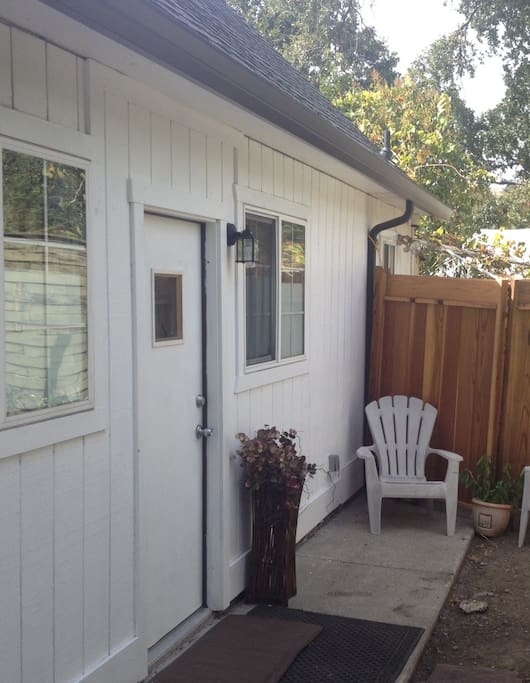 Private entrance with small patio out front. Very private and far removed from the main house.