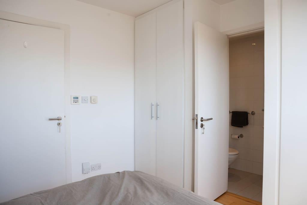Part of the wardrobe space + bathroom