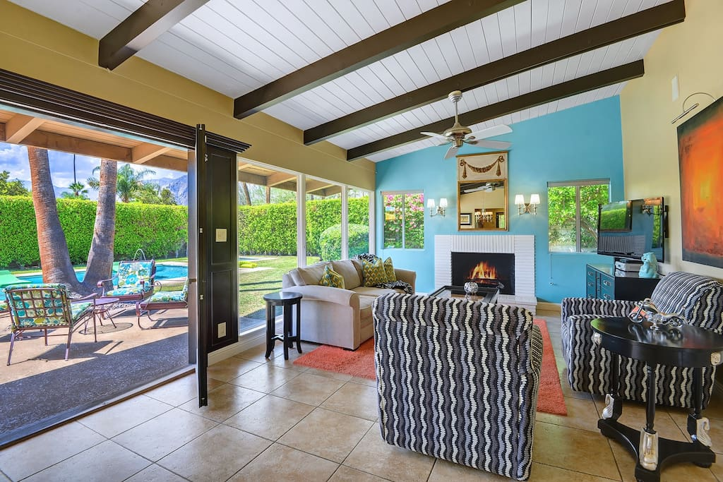 Living room with gas fireplace out to pool, spa, and grass yard