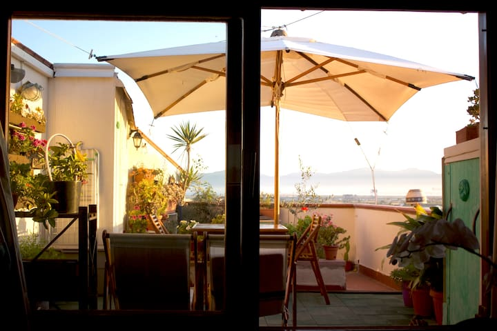 In Summer we open the parasol, and the terrace is even more enjoyable.