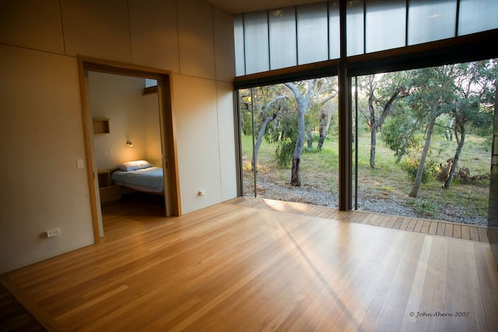 """Doors open fully as a """"balcony"""" to the bushland below"""
