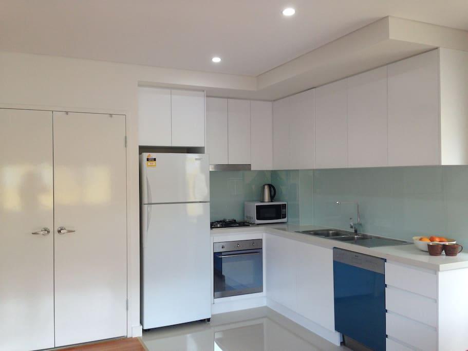 Full Kitchen, stove, oven, dish washer, Fridge, Microwave, Toast machine, washing machine and dryer