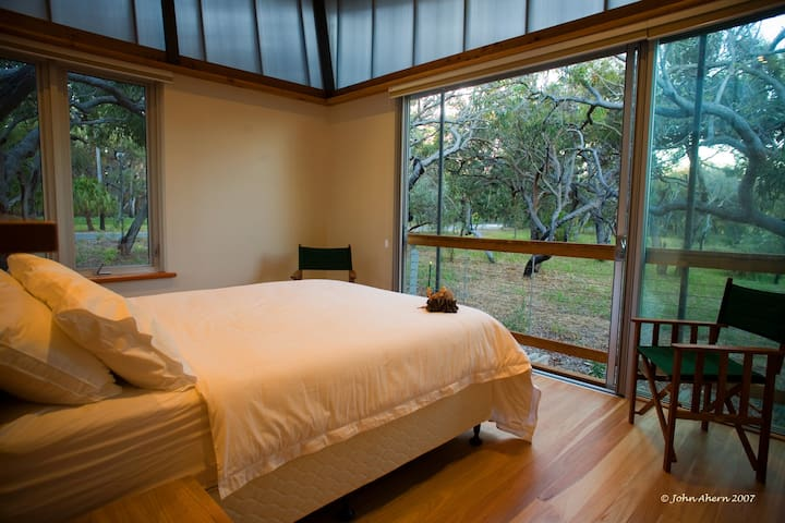 Second Queen bedroom has A/C, ceiling fan, plenty of storage and adjoining bathroom.
