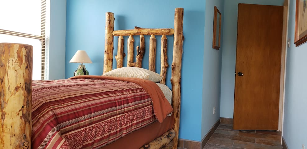 This Native themed bedroom has new twin Sealy Posture Pedic Cushion Firm Eurotop mattress.