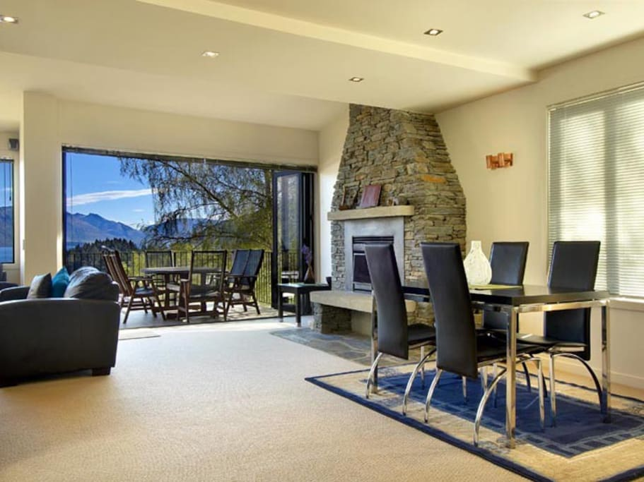 Open plan kitchen, dining and living area with lake and mountain views