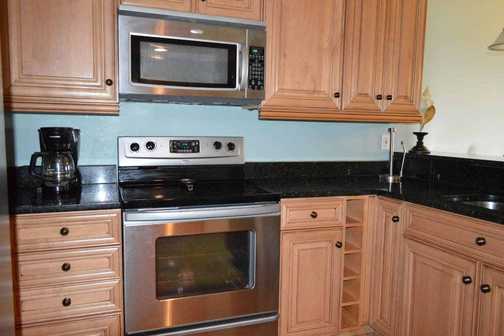 Fully renovated kitchen with granite and hardwood floors