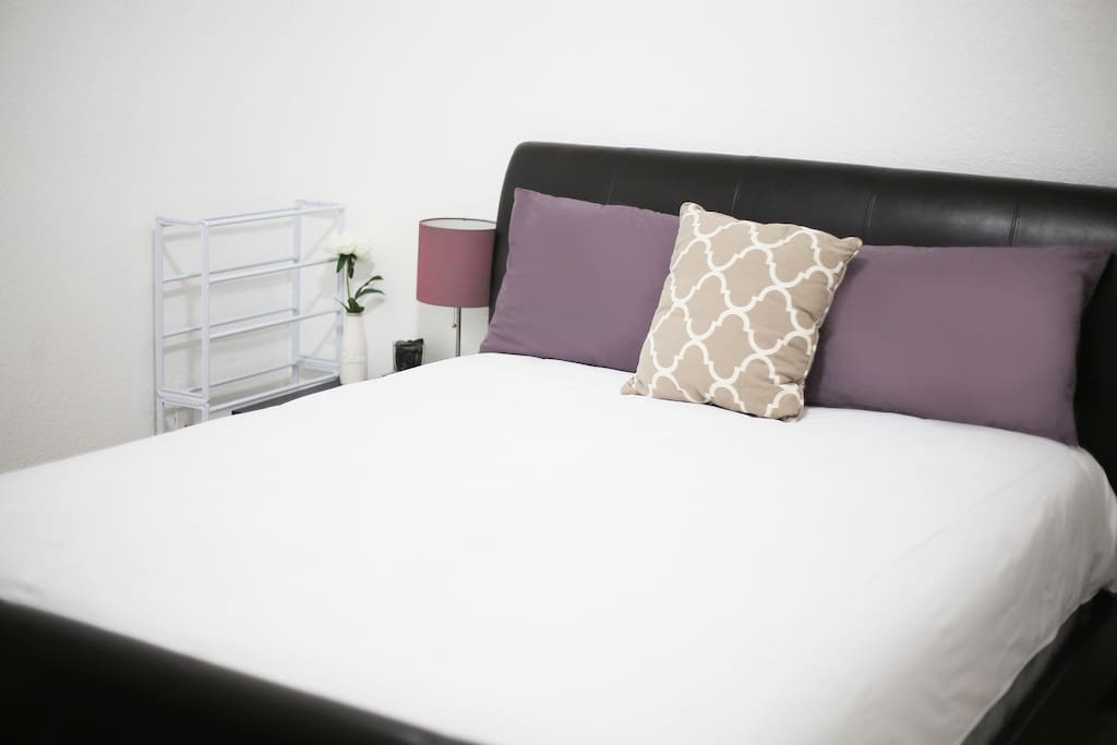 """welcome! private bedroom """"1""""  up to 1-2 guests w/ queen size bed, fresh clean linens & towels, storage cupboard & basket, closet, 2 night stands, lamp (bedding style changes)"""