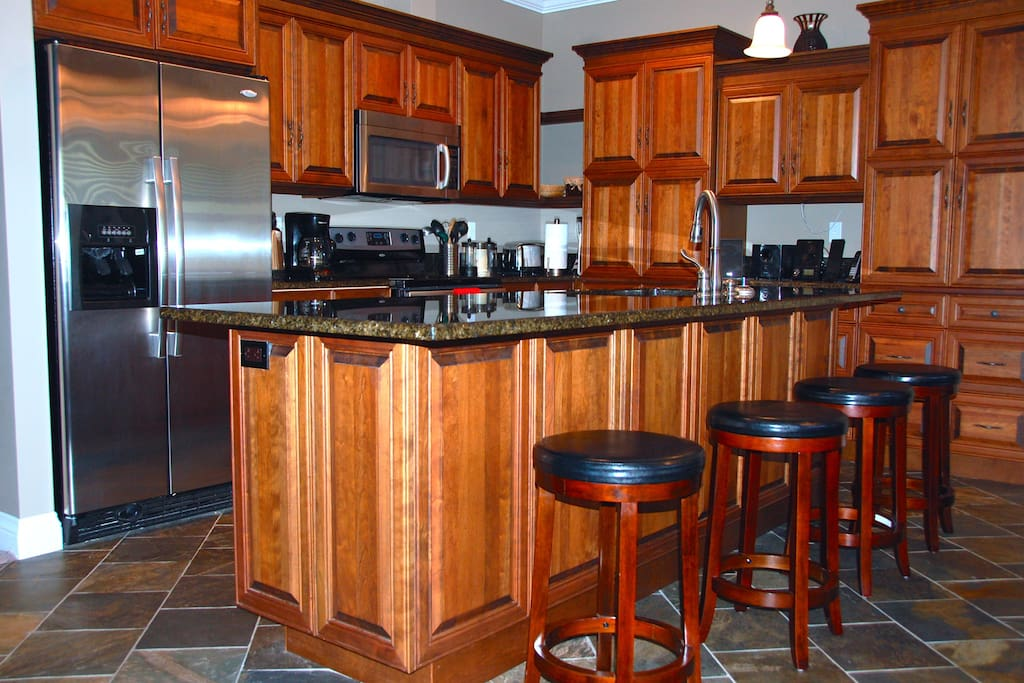High end kitchen with granite countertops and custom cabinetry. Stocked and ready to move in!