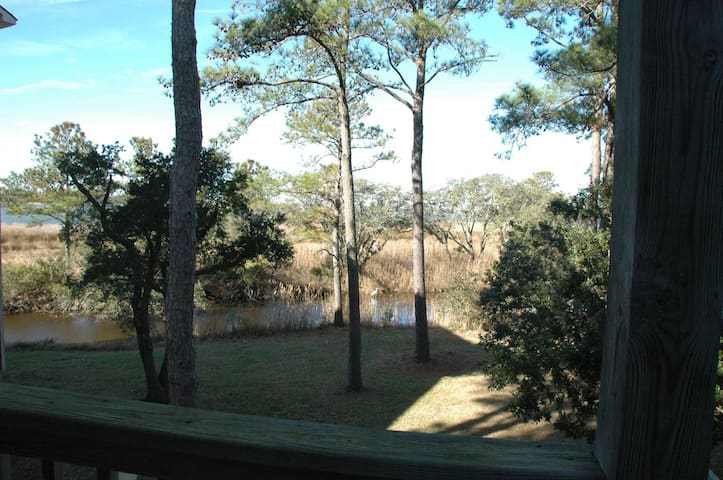 Drop a kayak or enjoy the view of the canal from the screened deck