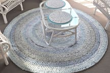 Lovingly hand made Rag Rug with all the colours of the beach.