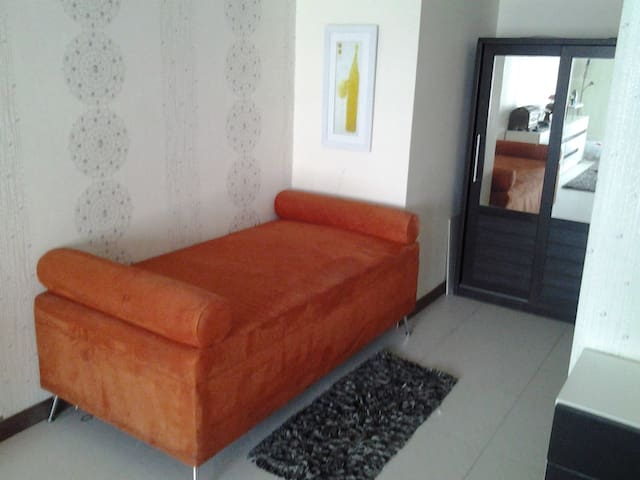 dressing lounge at far end of bedroom and opposite bathroom