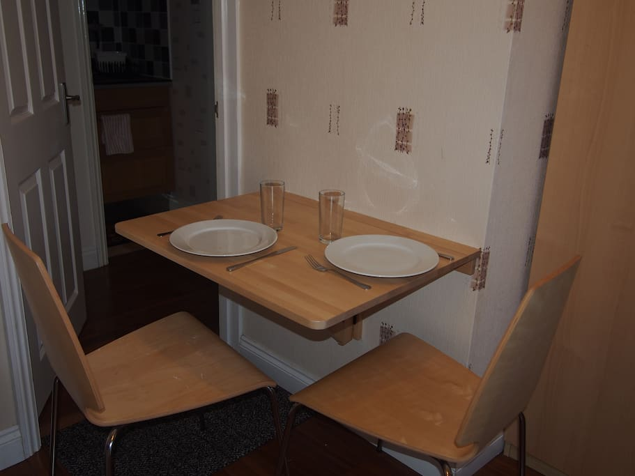 Dining table, folds down when not needed