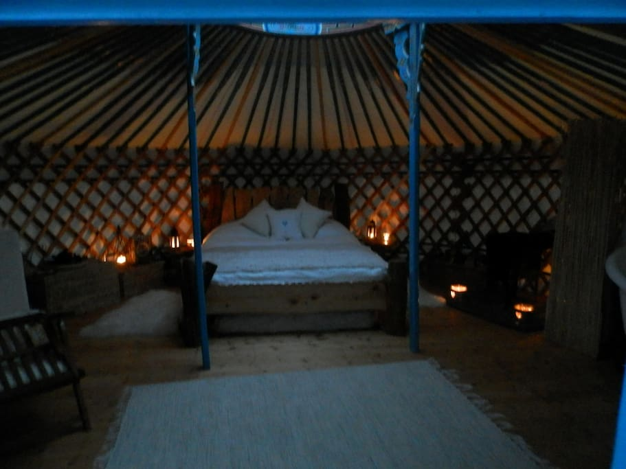 Cosy by candlelight... the yurt at Butterfly Meadow...
