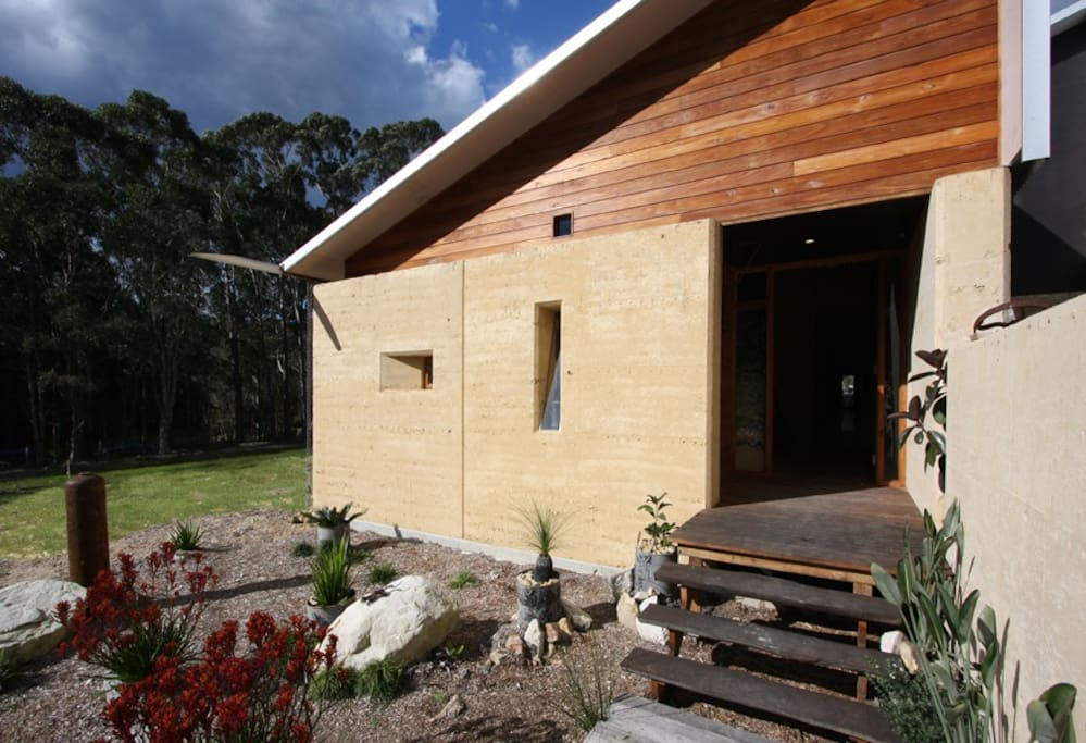 Rammed earth feature walls throughout