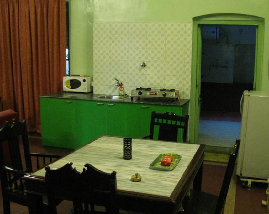 Open kitchen with Cooking Gas and Microwave oven. Attached bathroom